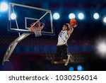 basketball player in action in... | Shutterstock . vector #1030256014