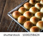 closeup bread rolls in mold on... | Shutterstock . vector #1030258624