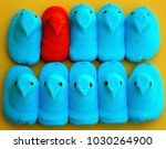 Small photo of Peep Chick candy one orange and the rest blue in a row to show diversity and standing out on a yellow background