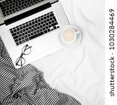workspace in bed with laptop... | Shutterstock . vector #1030284469