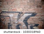 a striking wall of displaced... | Shutterstock . vector #1030318960