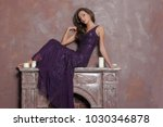 sexy brunette in a dress sits... | Shutterstock . vector #1030346878