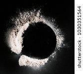 top view of flour on black... | Shutterstock . vector #1030351564