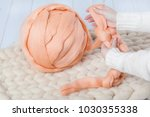 a ball of thick yarn and a... | Shutterstock . vector #1030355338