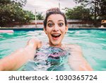 young mixed woman in the pool ... | Shutterstock . vector #1030365724