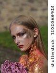 halloween girl with flowers ... | Shutterstock . vector #1030368403
