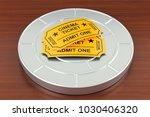 cinema tickets and film reel on ... | Shutterstock . vector #1030406320