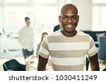 smiling young african designer... | Shutterstock . vector #1030411249