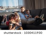 happy couple spending time with ... | Shutterstock . vector #1030411930