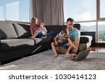 happy family. father  mother... | Shutterstock . vector #1030414123