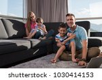 happy family. father  mother... | Shutterstock . vector #1030414153