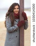 beautiful woman in grey coat...   Shutterstock . vector #1030414300
