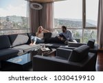 young couple relaxing at  home... | Shutterstock . vector #1030419910