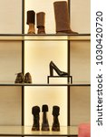 bright large luxury shoe store... | Shutterstock . vector #1030420720