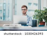 young intern working at the...   Shutterstock . vector #1030426393