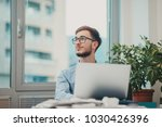 young intern working at the... | Shutterstock . vector #1030426396