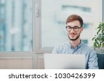 young intern working at the...   Shutterstock . vector #1030426399