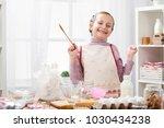 portrait of girl in kitchen...   Shutterstock . vector #1030434238