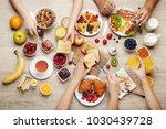 happy family having tasty... | Shutterstock . vector #1030439728