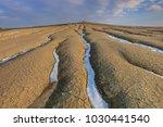 sunset in mud volcanoes. buzau... | Shutterstock . vector #1030441540