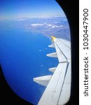 airplane wing with sky view | Shutterstock . vector #1030447900