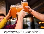 group of young friends in bar... | Shutterstock . vector #1030448440