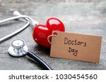 inscription doctors day with... | Shutterstock . vector #1030454560