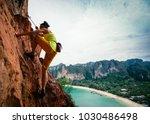 woman rock climber climbing on... | Shutterstock . vector #1030486498