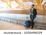 businessman waiting in the... | Shutterstock . vector #1030498339