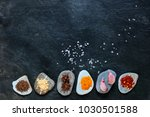 colorful spices on pebbles with ... | Shutterstock . vector #1030501588