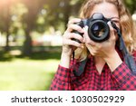 young female student taking... | Shutterstock . vector #1030502929