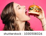 Close up of hungry girl with...