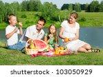 family resting on the lake | Shutterstock . vector #103050929