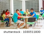 Stock photo high school students on a break in cafeteria 1030511830