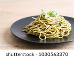 spaghetti with basil pesto  ... | Shutterstock . vector #1030563370