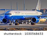 united airlines jet plane heads ... | Shutterstock . vector #1030568653