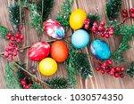 easter eggs on wooden background | Shutterstock . vector #1030574350