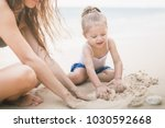 mom and happy baby playing near ... | Shutterstock . vector #1030592668