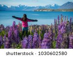 happy tourist woman at lake... | Shutterstock . vector #1030602580