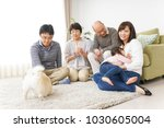 three generation family playing ... | Shutterstock . vector #1030605004