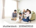 three generation family playing ... | Shutterstock . vector #1030605010