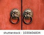 on the red door of the beast... | Shutterstock . vector #1030606834