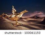 aladdin magic lamp on a desert | Shutterstock . vector #103061153