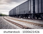 rail freight cars on rails | Shutterstock . vector #1030621426