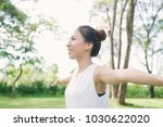 young asian woman yoga outdoors ... | Shutterstock . vector #1030622020