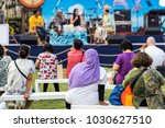 rear side of audiences sitting... | Shutterstock . vector #1030627510
