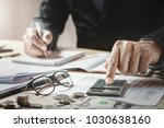 accountant working in office.... | Shutterstock . vector #1030638160