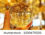 a glass orb in a hand with... | Shutterstock . vector #1030670320