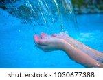woman hands in blue water.... | Shutterstock . vector #1030677388