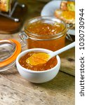 Small photo of Marco close up vertical image of home made organic marmalade in a glass persevering jar with toast in the background room for text over lay